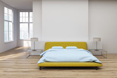 Yellow bed wooden floor, front Royalty Free Stock Image