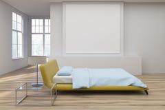 Yellow bed, wooden floor side Stock Image