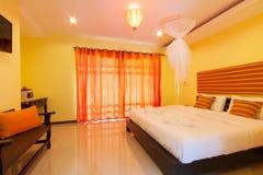 Yellow bedroom Stock Photography