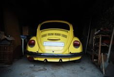 Yellow beetle in garage Stock Photos