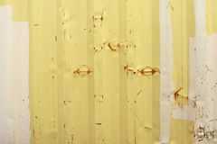 Yellow and beige metal walls of a container. Covered with rust Stock Photo