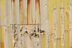 Yellow and beige metal walls of a container. Covered with rust Royalty Free Stock Image