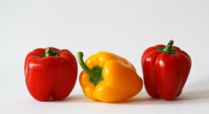 Yellow Bell Pepper Between 2 Red Bell Pepper Royalty Free Stock Photography