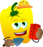 Yellow bell pepper as bricklayer with brick and trowel Royalty Free Stock Image