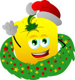 Yellow bell pepper with Christmas wreath and Santa hat Royalty Free Stock Photos