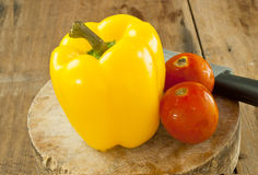 Yellow bell pepper on a cutting board for food. Royalty Free Stock Image