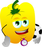 Yellow bell pepper with football or soccer ball Royalty Free Stock Image