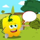 Yellow bell pepper gesturing a call me sign on a meadow with speech bubble Royalty Free Stock Photos
