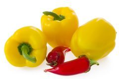 Yellow bell pepper and glass chilli on white Stock Photography
