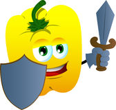 Yellow bell pepper guard with shield and sword Royalty Free Stock Photography
