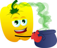 Yellow bell pepper holding cauldron with potion Stock Image