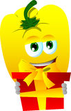 Yellow bell pepper holding gift box Stock Image