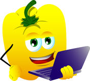 Yellow bell pepper holding laptop Stock Image