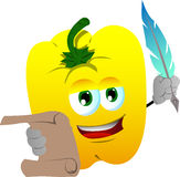 Yellow bell pepper holding paper scroll and feather Stock Photo