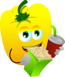 Yellow bell pepper holding popcorn and soft drink Royalty Free Stock Photos