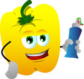 Yellow bell pepper holding toothpaste Stock Image