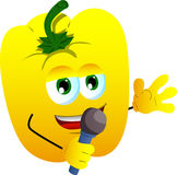 Yellow bell pepper hosting a show and talking into a microphone Royalty Free Stock Photography