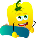 Yellow bell pepper with skateboard Stock Photo