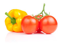 Yellow bell pepper and Three Vine fresh tomato Stock Images