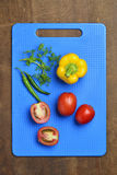 Yellow Bell Pepper, Tomato, Chili And Cilantro on Chopping Board Royalty Free Stock Photos