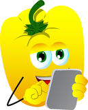 Yellow bell pepper using a tablet Stock Photo