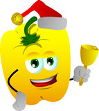 Yellow bell pepper wearing Santa's hat and playing bell Stock Photos