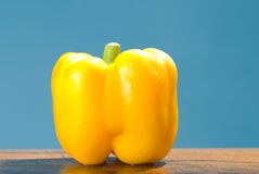 Yellow bell pepper on wood table Royalty Free Stock Photography