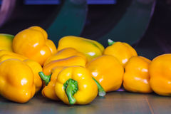 Yellow bell peppers on a conveyor belt Stock Photo