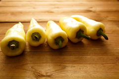 Yellow Bell Peppers wood background.  Stock Image