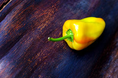 Yellow bell peppers on wooden table Stock Photography