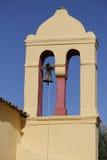 Yellow bell tower in Moraitika. Corfu. Greece. Royalty Free Stock Photo