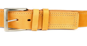 Yellow Belt. Yellow Leather Belt with Stitching and Silver Buckle isolated on white background royalty free stock image