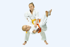 With yellow belt sportswoman is training throw Royalty Free Stock Image