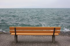 Free Yellow Bench On The Lake In Switzerland. Royalty Free Stock Images - 152923619