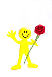 Yellow bendy smile face figure  with red rose Royalty Free Stock Image