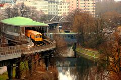 Yellow Berlin U-bahn exiting the station platform on a winter day. royalty free stock photo