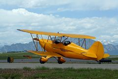 Yellow Bi-Plane stock photo