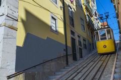 Yellow Bica Elevator Elevador da Bica in the historic neighborhood of Bica in Lisbon, Portugal Stock Photography