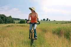 Yellow bicycle. Women ride on yellow bicycle royalty free stock images