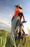 Yellow bicycle. Young woman and yellow bicycle royalty free stock photo