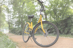 Yellow bicycle on the Boulevard. A yellow bicycle on the Boulevard Stock Image