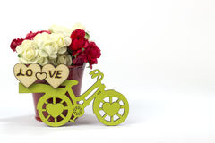 Yellow bicycle with a bucket of flowers & heart, white. Yellow bicycle with a bucket full of flowers in white background Royalty Free Stock Images