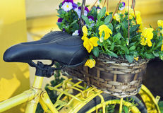 Yellow bicycle decorated with flowers Royalty Free Stock Photos