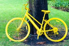 Yellow bicycle exposed in York city as a symbol of  Tour de France through Yorkshire Stock Image