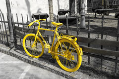 Yellow bicycle on the gray background Stock Image
