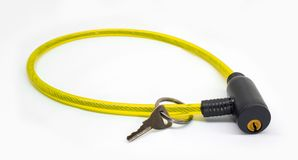 Yellow bicycle lock for bike with key isolated on white background Stock Photos