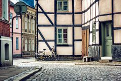Yellow bicycle near the building facade with a window, Scandinav Stock Photo