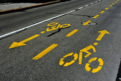 Yellow bicycle path signs Stock Image