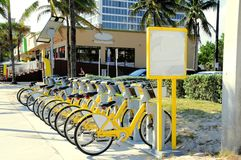 Yellow bicycle rental. Rental of bikes in Fort Lauderdale, South Florida stock photography