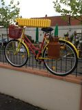 Yellow Bicycle. Used as a garden ornament Stock Image